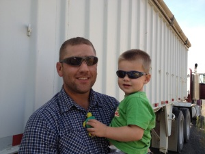 Farmer Todd Strader and his son