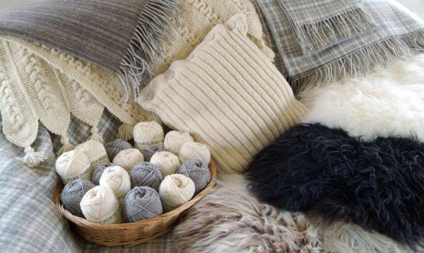 Cozy wool blankets and sweaters. Photo source