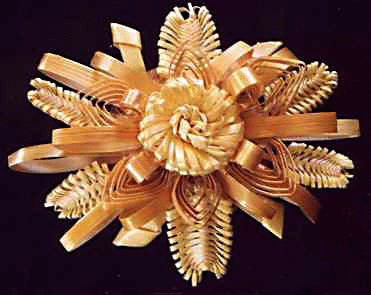 This lovely brooch is a good example of Swiss straw work