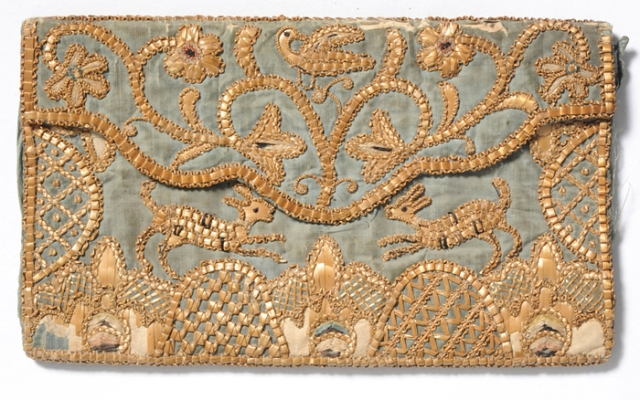A fine antique example of straw embroidery