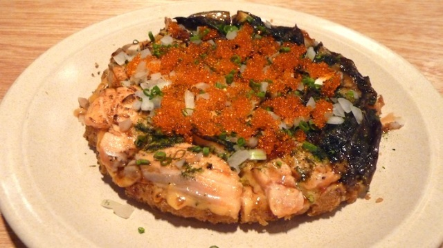 Salmon and eel pizza. Thanks but no.  Photo source