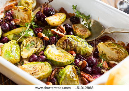 stock-photo-roasted-brussels-sprouts-with-grapes-nuts-and-balsamic-vinegar-151912868